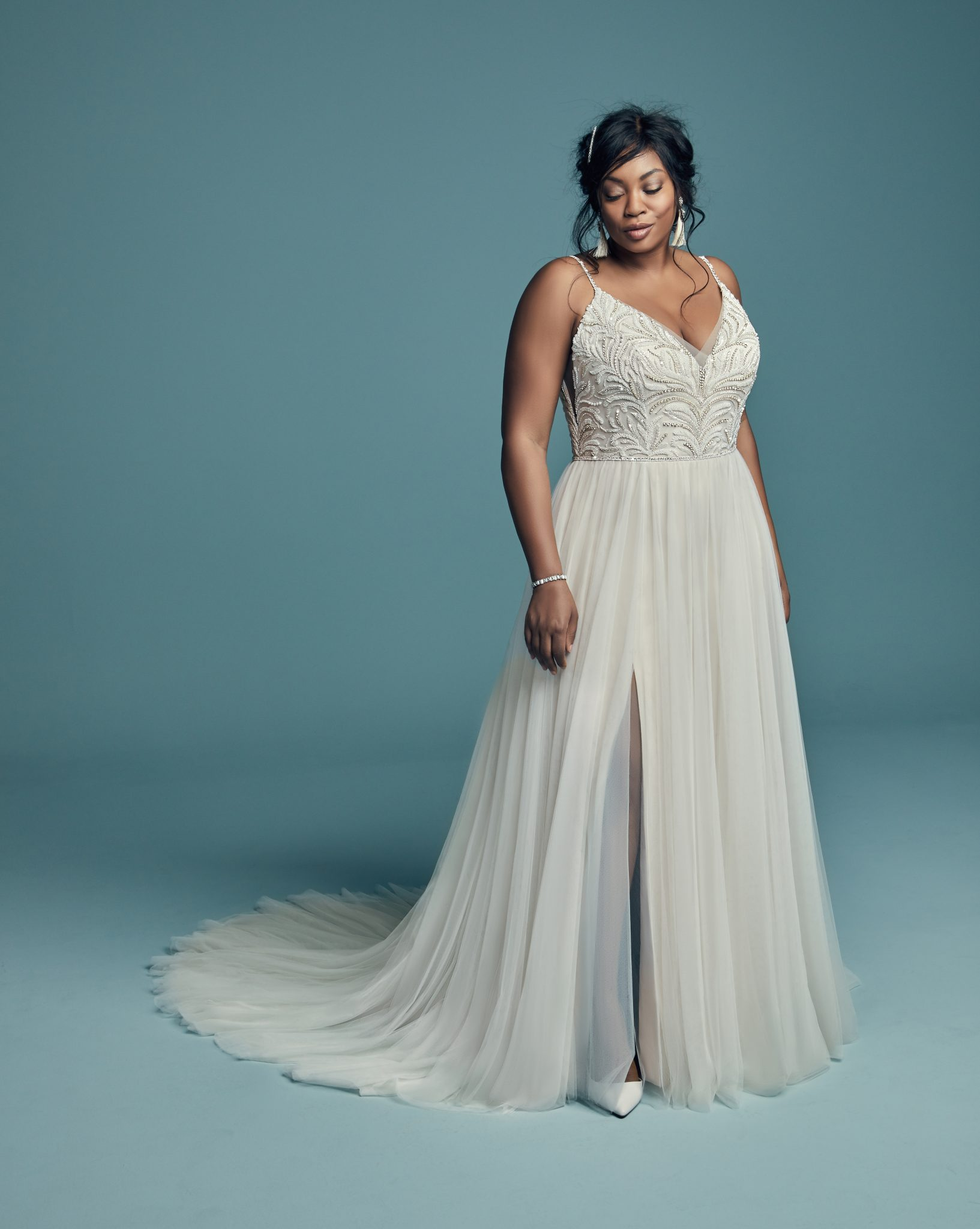 102bc1bf054 ... our gowns offer something for every bride. Find your dream dress from   1200 –  4500. Celebrate Your Curves